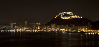 Alicante by night. Alicante city beach and skyline at night with lighted castle Royalty Free Stock Photo