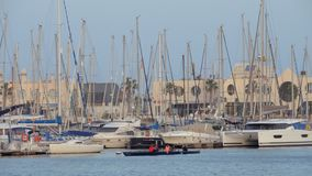 Yachts and rowing boat in the port of Alicante, Spain stock video footage