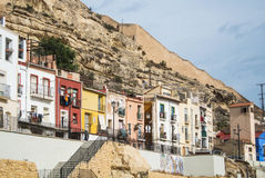 ALICANTE, SPAIN - FEBRUARY 12, 2016: Bright colored traditional houses at Barrio Santa Cruz. A district near Santa Barbara castle, Alicante, Spain Royalty Free Stock Image
