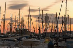 Port of Alicante during a cold winter sunset. Stock Photos