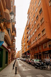 ALICANTE, SPAIN - JULY 14, 2015: Old street with city hall in sp Royalty Free Stock Photography