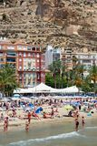 Tourists sunbathing on a Postiguet Beach of Alicante city. Spain Royalty Free Stock Photography