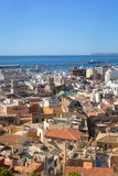 Beautiful old place in Alicante city, Santa Cruz. Alicante, Spain, May 2018. Rooftops, the port and the sea. Alicante, Spain, May 2018: Beautiful place in Royalty Free Stock Photo
