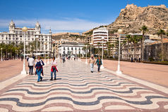 Alicante in Spain. Wide view from the Muellle Levante quayside to the castle of Santa Barbara and municipal buildings in Alicante, Spain Stock Images
