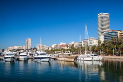 Alicante. View of Alicante harbour with palms and hotel building during sunny day stock photo