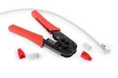 Alicates, cabo e conectores de friso com os tampões para o twisted pair fotos de stock royalty free