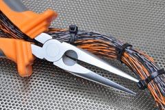 Alicates con los cables eléctricos Fotografía de archivo libre de regalías