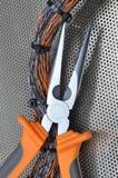 Alicates con los cables eléctricos Foto de archivo libre de regalías
