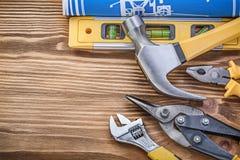 Alicates nivelados do martelo de garra das luvas protetoras do desenho da construção Imagens de Stock