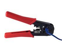 Alicates que prensan y cordón azul Imagen de archivo libre de regalías