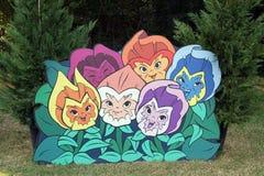 A Alice em flores do país das maravilhas Fotografia de Stock Royalty Free