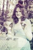 Alice i underlandTeadeltagare royaltyfria bilder