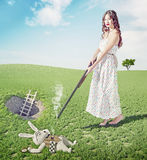 Alice kills white rabbit. Creative concept/  Photo and cg elements combinated Royalty Free Stock Photography