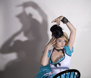 Alice look a like. Young woman with a top hat and white and blue faery tale dress Royalty Free Stock Photo