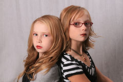 Alice and Rosalie look alikes. Two young girls looking like Alice and Rosalie from the twilight saga stock photography