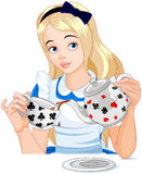 Alice takes tea cup. Alice pours a cup of tea from the kettle Stock Images