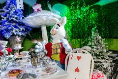 Alice and  the tea party. Whitchurch, Bristol, UK - November 19, 2016:  Christmas decorations on sale, Alice in Wonderland theme in Whitehall  garden centre Stock Image