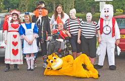 Alice in Wonderland. An image of a group from Leonard Cheshire Home supporting the charity Children 1st by taking part in the Raft race down the river Ness on Royalty Free Stock Photo