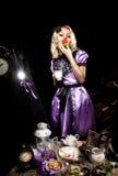 Alice in wonderland eat cake Stock Photo