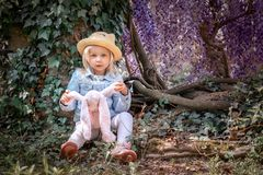 Alice in Wonderland fairy tale. Beautiful fairy girl with rabbit royalty free stock image