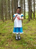 Alice. In wonderland giant magical dressup girl child forrest enchanted storybook fairytale Stock Photography
