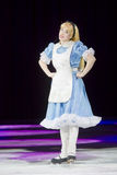 Alice in Wonderland on Skates. GREEN BAY, WI - MARCH 10: Alice in Wonderland in her blue dress and skates at the Disney on Ice Treasure Trove show at the Resch Stock Photo