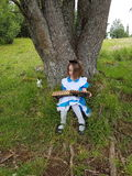 Alice in wonderland. Storybook fairytale girl dressup child rabbit Stock Photography