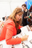 Alicia Sanchez-Camacho giving autograph on the book Royalty Free Stock Image