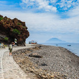 Alicudi island shore with Filicudi on the background, Sicily. royalty free stock photos