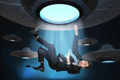Alien abduction concept. Young man is abducted by UFO.  Vector Illustration