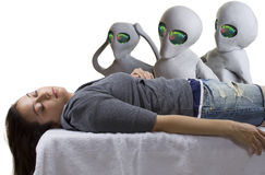 Alien Abduction. Young woman is the victim of an alien abduction royalty free stock images