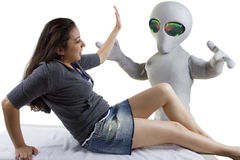Alien Abduction. Young woman is the victim of an alien abduction Stock Image