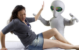 Alien Abduction. Young woman is the victim of an alien abduction stock photography