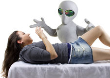 Alien Abduction. Young woman is the victim of an alien abduction royalty free stock photography