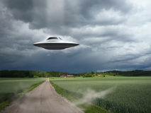 Alien aircraft UFO landing. Alien aircraft, landing on an abandoned road royalty free stock photos