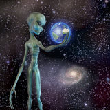 Alien being ponders earth Stock Photo