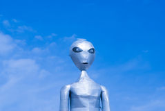 Alien on blue sky. RACHEL, NEVADA/USA – March 30, 2010: The tall metal Alien figure at the Alien Research Center located on Nevada's Extraterrestrial stock photos