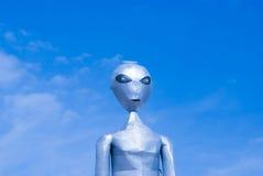 Alien on blue sky Stock Photos