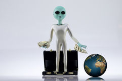 Alien Business. Buy world with money briefcase royalty free stock images