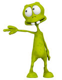Alien cartoon pointing Stock Images