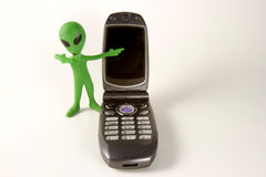 Alien with a Cell Phone Royalty Free Stock Photos