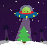 Alien and christmas tree Stock Photography