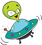 Alien in color. Cute green alien flying with his UFO Royalty Free Stock Photo