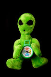 Alien with compass. This stock photo shows a plush alien holding a compass Stock Photography
