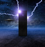 Alien Craft Approaches Monolith Stock Photography