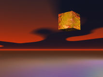 Alien Cube. Over a sea and sunset Royalty Free Stock Images