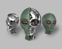 Alien cyborg 1. Three heads of extraterrestrial cyborg with a metal skeleton dissected. On a gray background Royalty Free Stock Photos