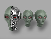 Alien cyborg 3. Three heads of extraterrestrial cyborg with a metal skeleton dissected. On a gray background Stock Photos