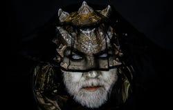 Alien, demon, sorcerer makeup. Demon on black background, close up. Dark arts concept. Senior man with white beard. Alien, demon, sorcerer makeup. Demon on black stock photography