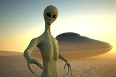 Alien in desert with UFO Royalty Free Stock Image
